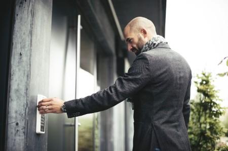 Businessman entering keycode open office door