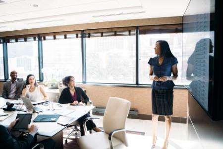 Businesswoman presentation meeting board room screen