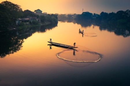 fisherman in traditional rowboat