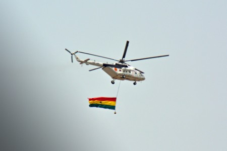 Helicopter with Ghana Flag overflying Accra Independence Day celebrations