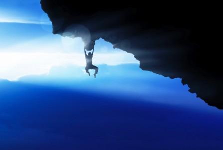 man climbing mountains