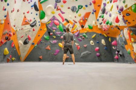 Man standing indoor climbing the gym