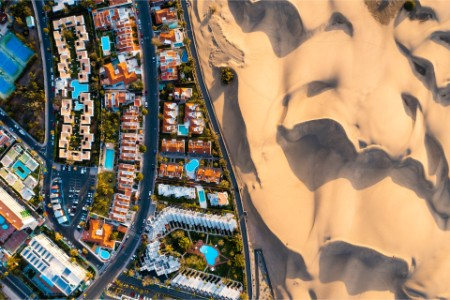 Overhead view of cityscape and sand dunes