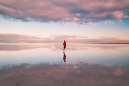 Person standing on the flooded bonneville salt flats Utah USA