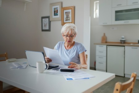Senior Woman Online Banking While Planning Her Home Budget