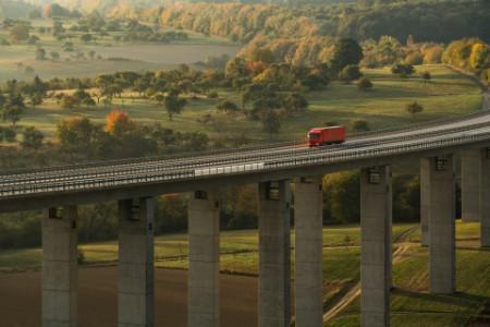 Red truck running over the bridge