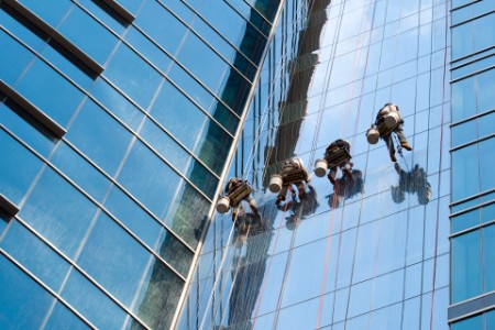 Window washer team cleaning high rise exterior