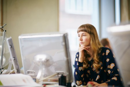 Woman focused at computer inmodernoffice