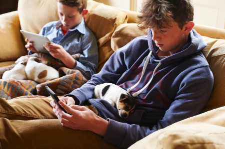 boys digital tablet cell phone puppies laps