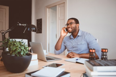 A business man on phone while working from home