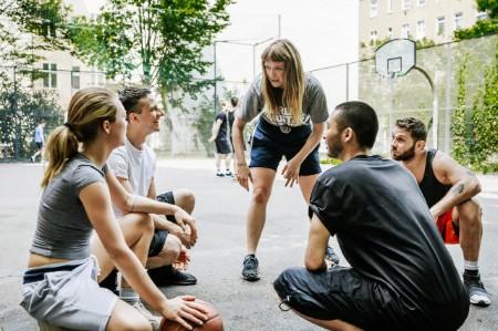 Friends huddled talking basketball tactics