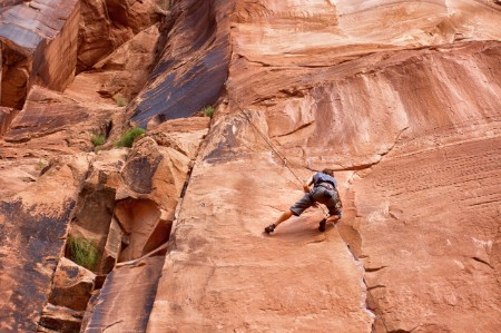 Man climbing rock wall moab
