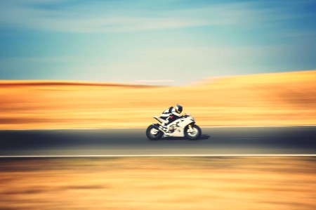 Motorbike speeding country road