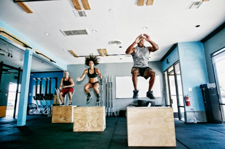 People working out jumping gym