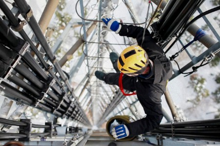 Telecommunication engineer repairing antenna