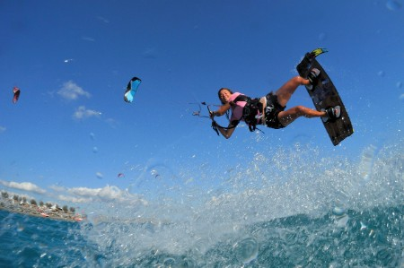 Woman freestyle kitesurf
