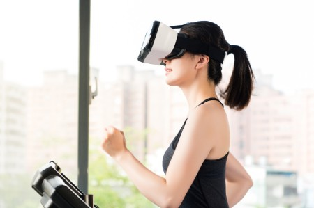 woman running on treadmill with vr headset