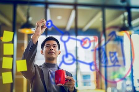 businessman coffee writing data