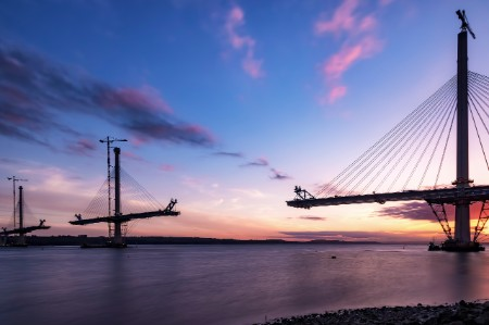 Scotland's Queensferry bridge under construction at sunset