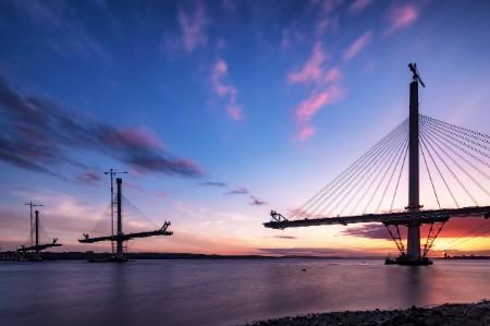 Scotland's Queensferry bridge under construction at sunset