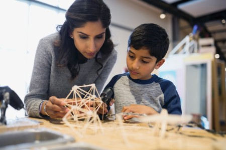 Mother son assembling model science