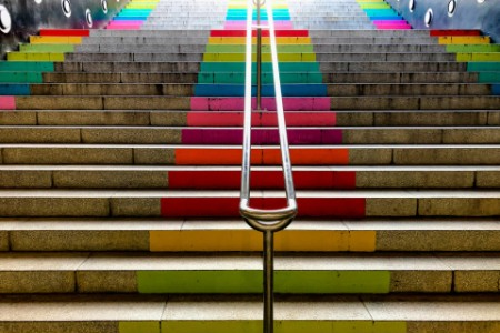 rainbow colors in the Barcelona city street stairs