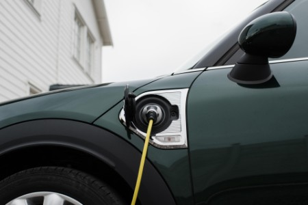 Electric car lead plugged into an electric car at home