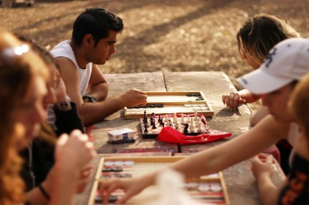 backgammon player plots strategic move