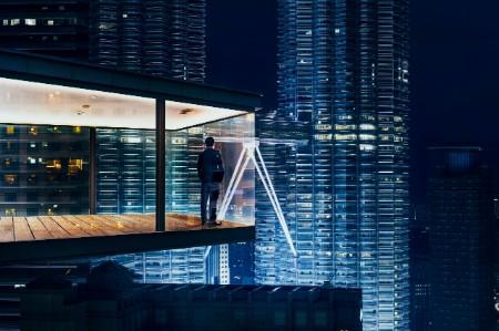 ey businessman modern office night city skyline
