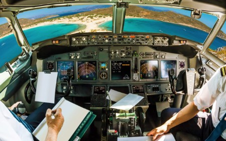 Pilots in plane using autopilot