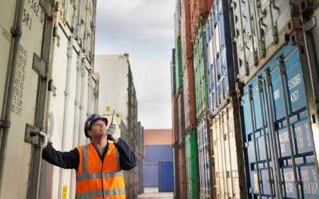 A worker surrounded by containers