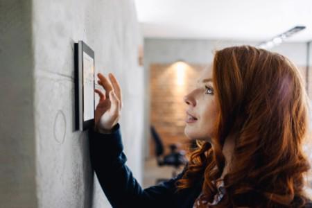 Women using wall mount digital device