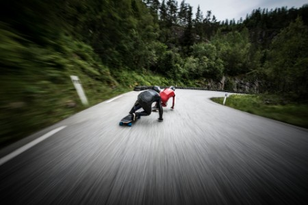 Longboarders chasing down a road in Norway