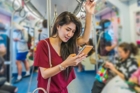 asian woman on phone