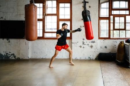 male boxer training sandbag