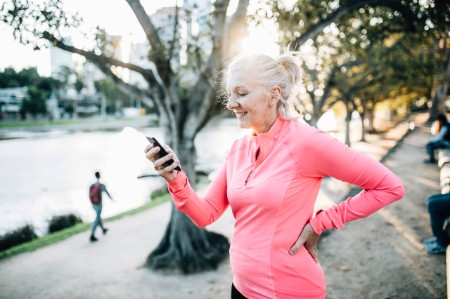 runner browses smart phone
