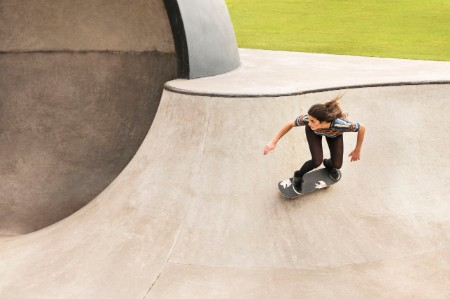 Woman skateboarding bowl