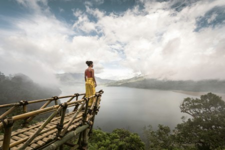 Woman looking over the jungle in southeast Asia