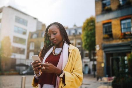 Woman texting street London