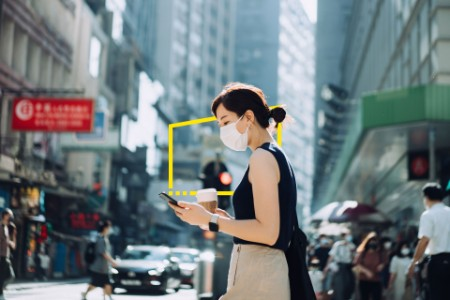 Young Asian woman with protective face mask