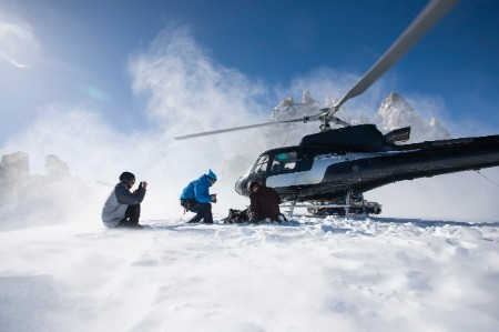 Three snowboarders exiting helicopter Trient Swiss Alps