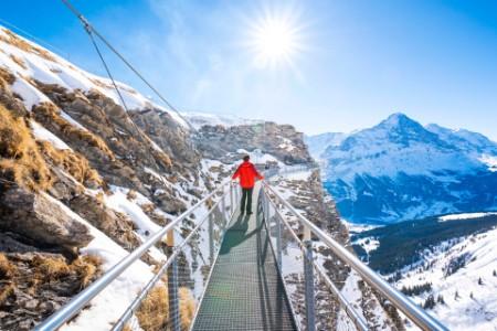 Tourist standing suspended walkwayswiss alps grindelwald switzerland