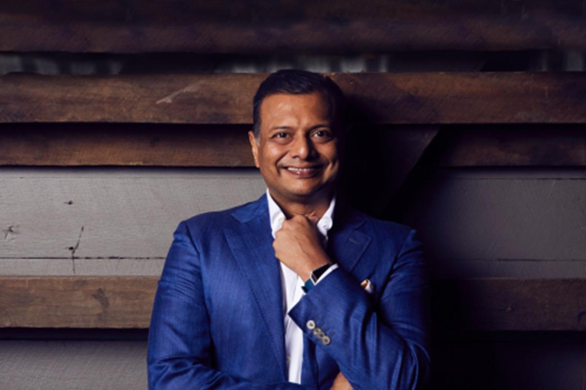 A photographic portrait of Girish Jhunjhnuwala