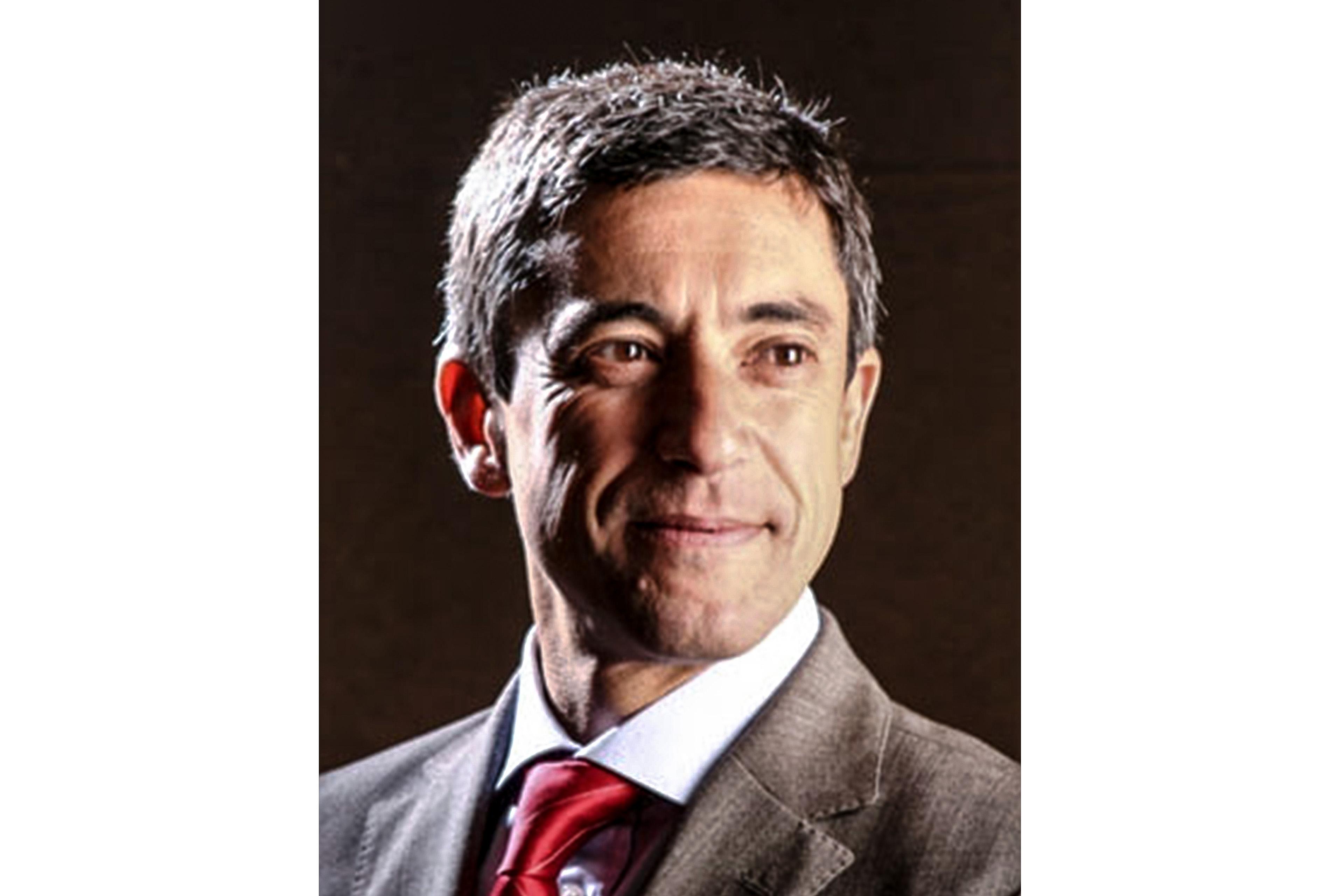 A photographic portrait of Sergio Ricardo Romani