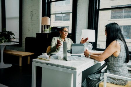 Female financial advisor in discussion with female business owner