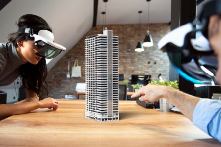 people working virtual 3D building AR glasses