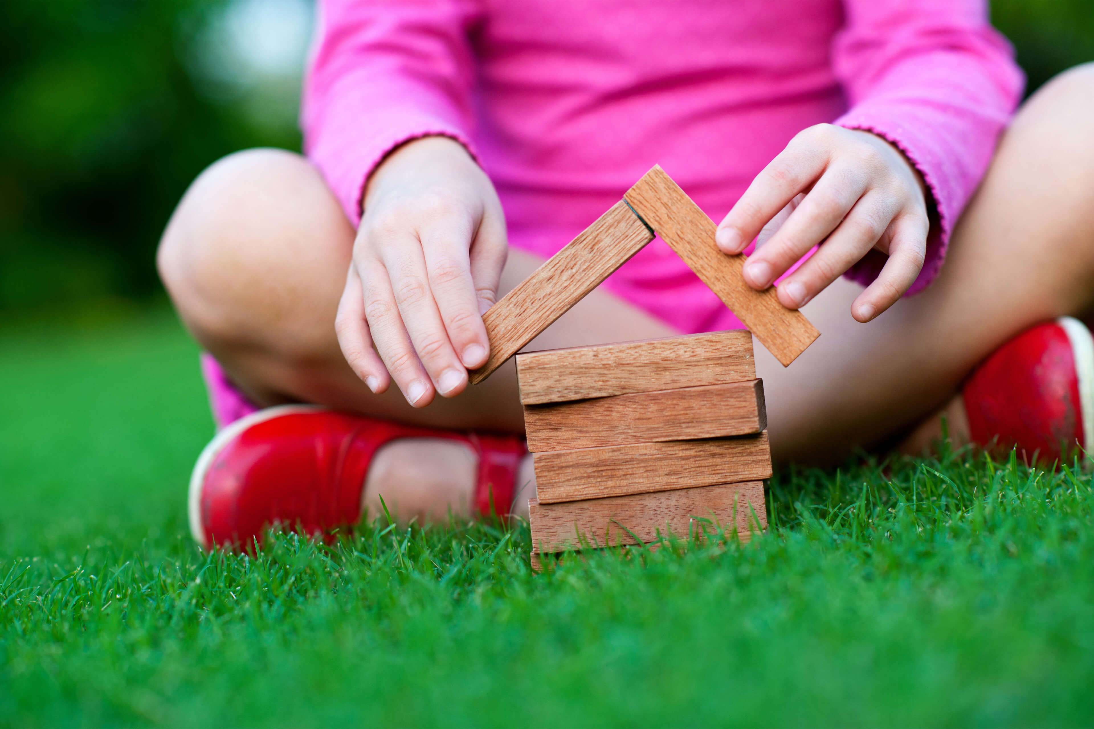 Child with wooden building blocks