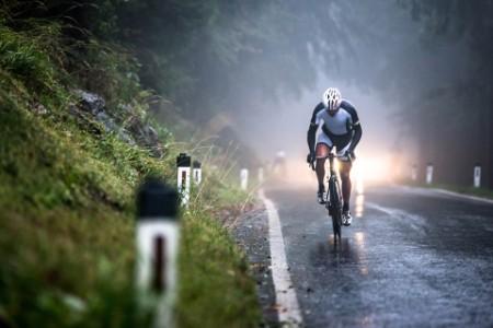 Man cycling on a wet road in salzburg austria