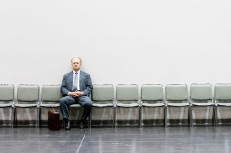 man suit waiting interview chairs