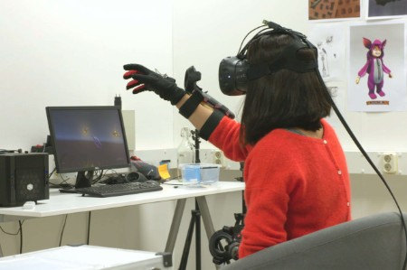 Woman using virtual reality glove